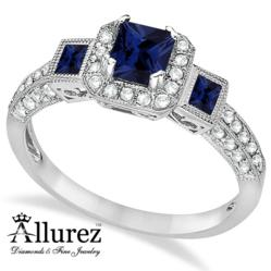 Three-stone princes-cut sapphire and diamond engagement ring.